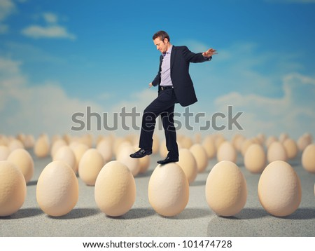 caucasian businessman walk on 3d eggs
