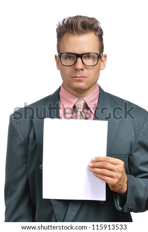 Caucasian businessman with glasses in fashionable suit holds blank paper with copy space on white background