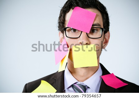 caucasian businessman with post it on his face