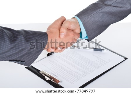 caucasian businessmen handshake after sign contract, isolated on white and business background, with clipboard, documents and empty copy space. Communication, greeting, agree, congratulation concept.