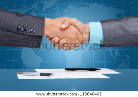 caucasian businessmen handshake after sign up contract, over blue digital world globe map  background, Concept of global international business collaboration, communication