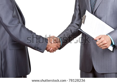 Caucasian businessmen in elegant suits, hold folder, files, documents in hand, handshake isolated on white background, with empty copy space. Communication, greeting, agree, congratulation concept.