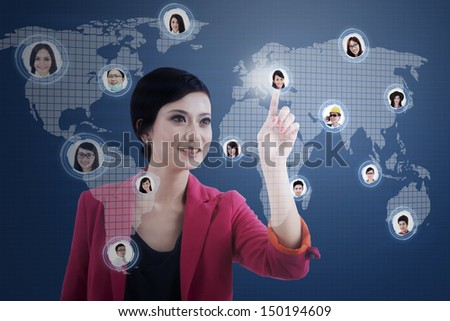 Caucasian businesswoman clicking on the social network map over a blue digital world map #150194609
