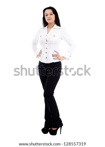 Caucasian businesswoman in full length pose isolated on white background. Hands in waist. Business concept