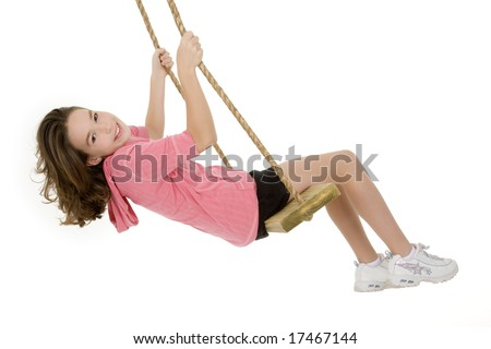 Caucasian child playing on a swing on white background - stock photo