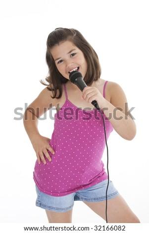 Caucasian children singing karaoke on a white background