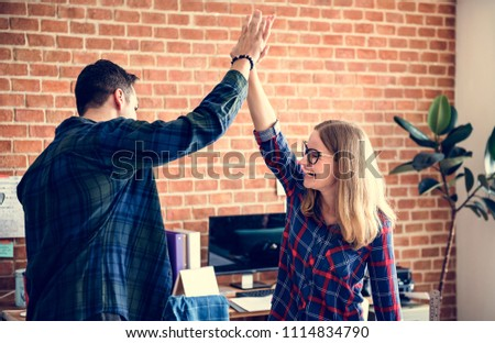 Caucasian colleagues give each other high five #1114834790