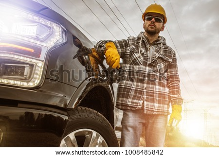Caucasian Contractor in His 30s and His Modern Heavy Duty Pickup Truck For Heavy Loads.
