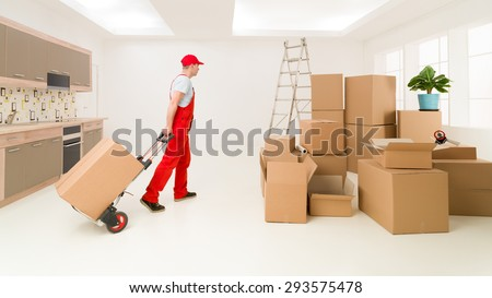 caucasian deliveryman in red uniform holding hand truck, delivering boxes to new house