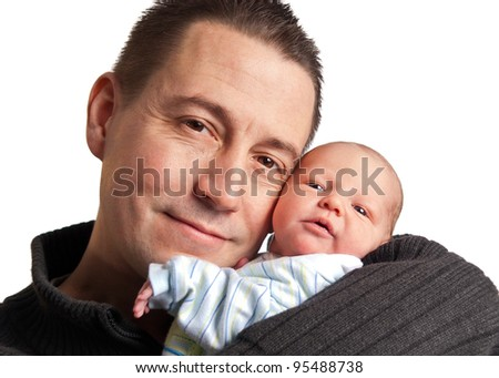 Caucasian father and newborn baby son on white background