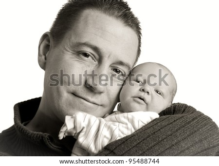 Caucasian father and newborn baby son on white background,black and white