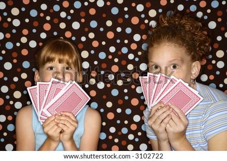 Caucasian female children holding cards.