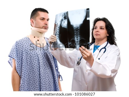 Caucasian female doctor looking at neck x-ray isolated on white background