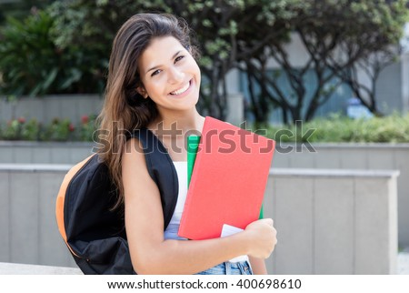 Caucasian female student looking at camera