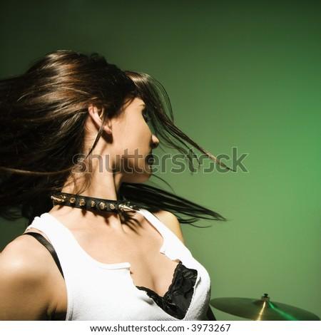 Caucasian female swinging her hair.