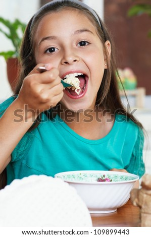 caucasian Girl eating spaghetti