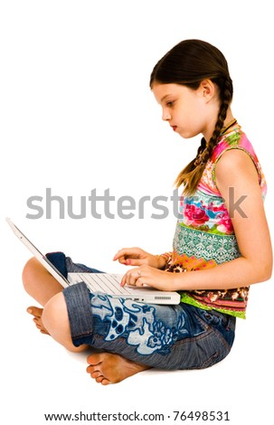 Caucasian girl using a laptop and posing isolated over white