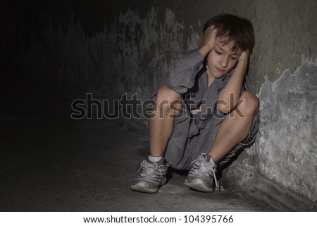 Caucasian guy frustrated sitting in a deserted place
