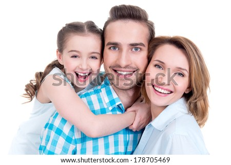 Caucasian happy young family with little girl and pretty white smiles - looking at camera