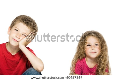 caucasian little boy bored and girl smiling portrait isolated studio on white background - stock photo