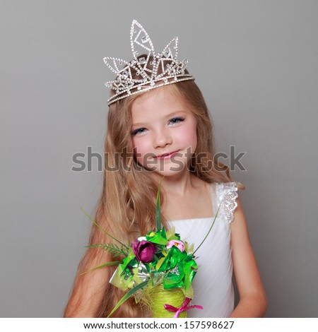 0ee233c482a7 Caucasian little girl with beautiful long hair in the crown and a white  dress with a