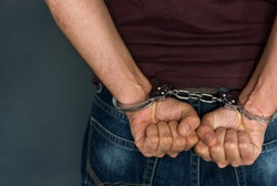 Caucasian male arrested and with handcuffs