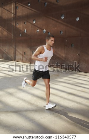 Caucasian male athlete doing exercise outdoor