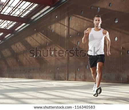 Caucasian male athlete doing exercise outdoor - stock photo