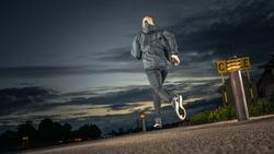 Caucasian male jogging in night time