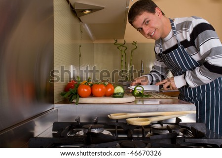 Caucasian male preparing food in home kitchen. Lifestyle