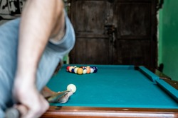 caucasian man breaking in game of pool in Antigua Guatemala