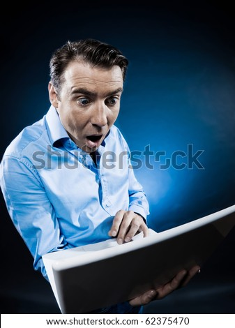 caucasian man computing stun portrait isolated studio on black background