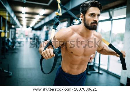 Caucasian man exercising suspension training trx #1007038621