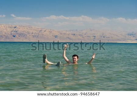 Caucasian man floating in the waters of the Dead Sea in Israel