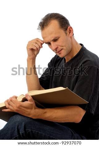 caucasian man holding a book and reading, over white background