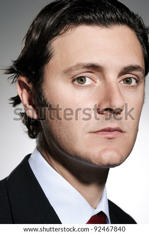 Caucasian man in business attire poses for a serious portrait in the studio