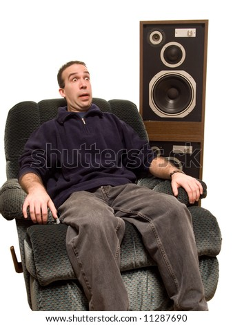 Caucasian Man Listening To Music, isolated against a white background