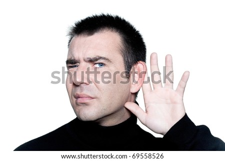 caucasian man portrait  gesturing with hearing aid speak up portrait on studio isolated white background