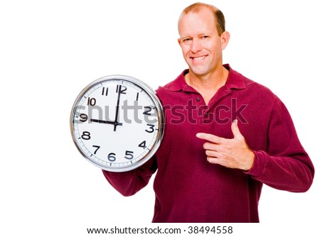 Caucasian man showing a clock and smiling isolated over white