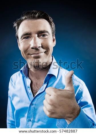 caucasian man thumb up portrait isolated studio on black background