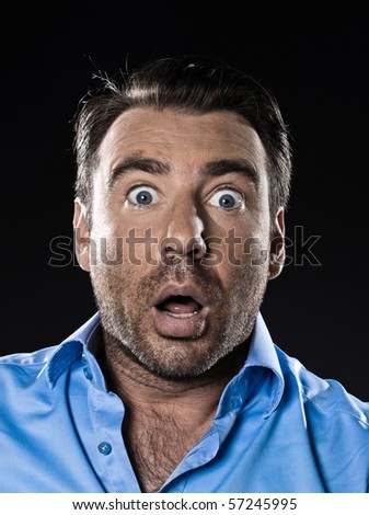 caucasian man unshaven portrait fear stuned isolated studio on black background