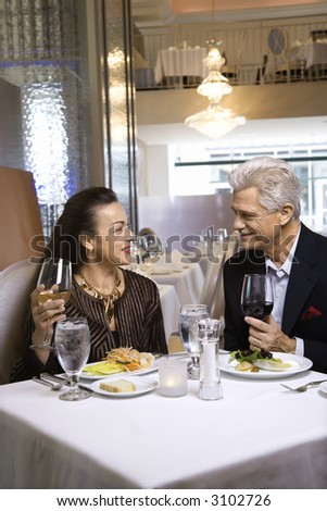 stock photo caucasian mature adult male and prime adult female sitting at restaurant table 3102726 Get all these Free Porn No Credit Card Sites 100% 4FREE