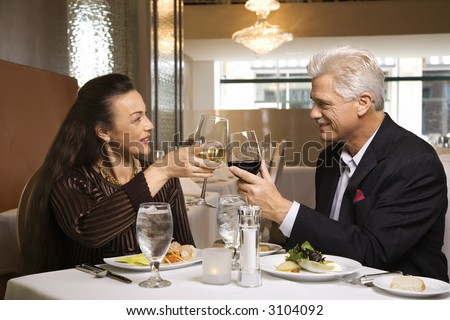 stock photo : Caucasian mature adult male and prime adult female sitting at ...