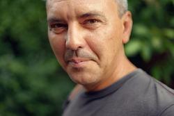 Caucasian mature man close up portrait. Real people authentic lifestyle portrait.