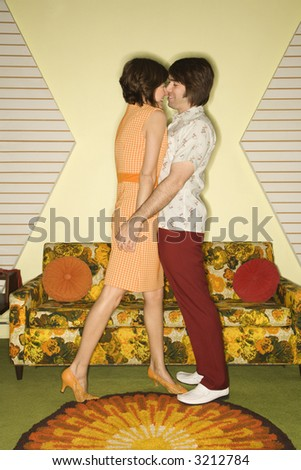 stock photo : Caucasian mid-adult couple wearing vintage clothing standing ...