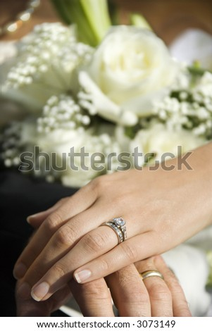 stock photo Caucasian midadult male and female hands with wedding rings