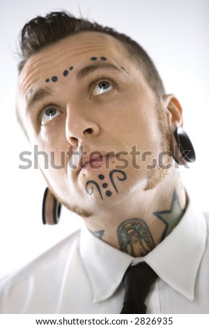 stock photo : Caucasian mid-adult man with tattoos and piercings.