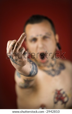 adult tattoo. on finger. with tattoos