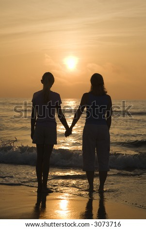 Holding Hands In Sunset. on beach at sunset holding