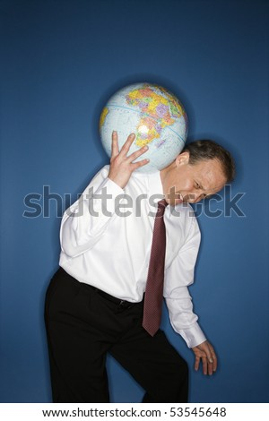 Caucasian middle aged businessman carrying weight of the world on his shoulders.